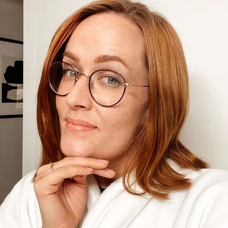 light brown hair color on person with shoulder-length hair wearing glasses