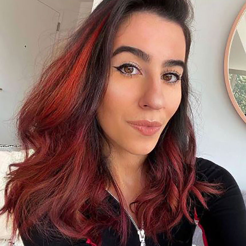 person with red for brown hair color on pre-lightened highlights