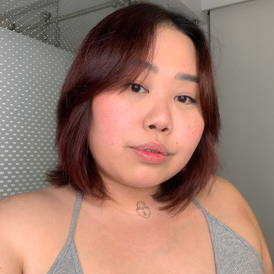 person with rose gold for brown hair color on short dark hair
