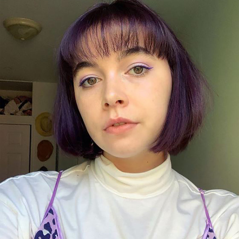amethyst purple hair color on person with short brown hair