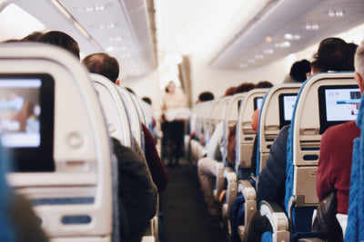 Do Face Masks on a plane reduce risk of getting COVID?