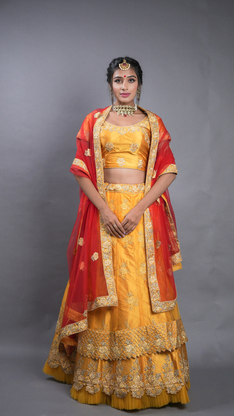 Yellow Silk Embroidered Cutwork Bridal Lehenga Choli