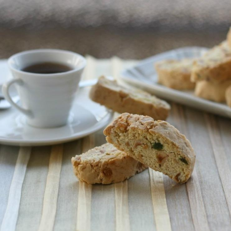 Two cantucci with coffe in the background