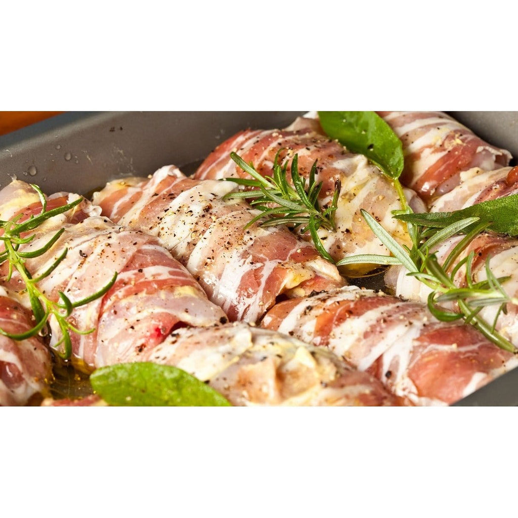 Pieces of meat rolled in pancetta slices with herbs and spices