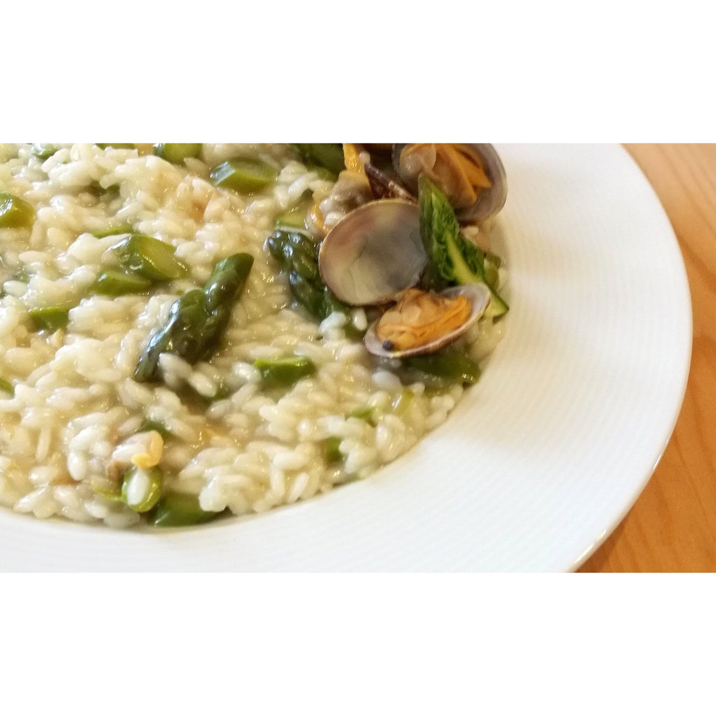 One plate of risotto Vialone Nano with asparagus and clams