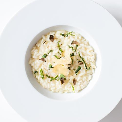 One plate of risotto carnaroli with herbs