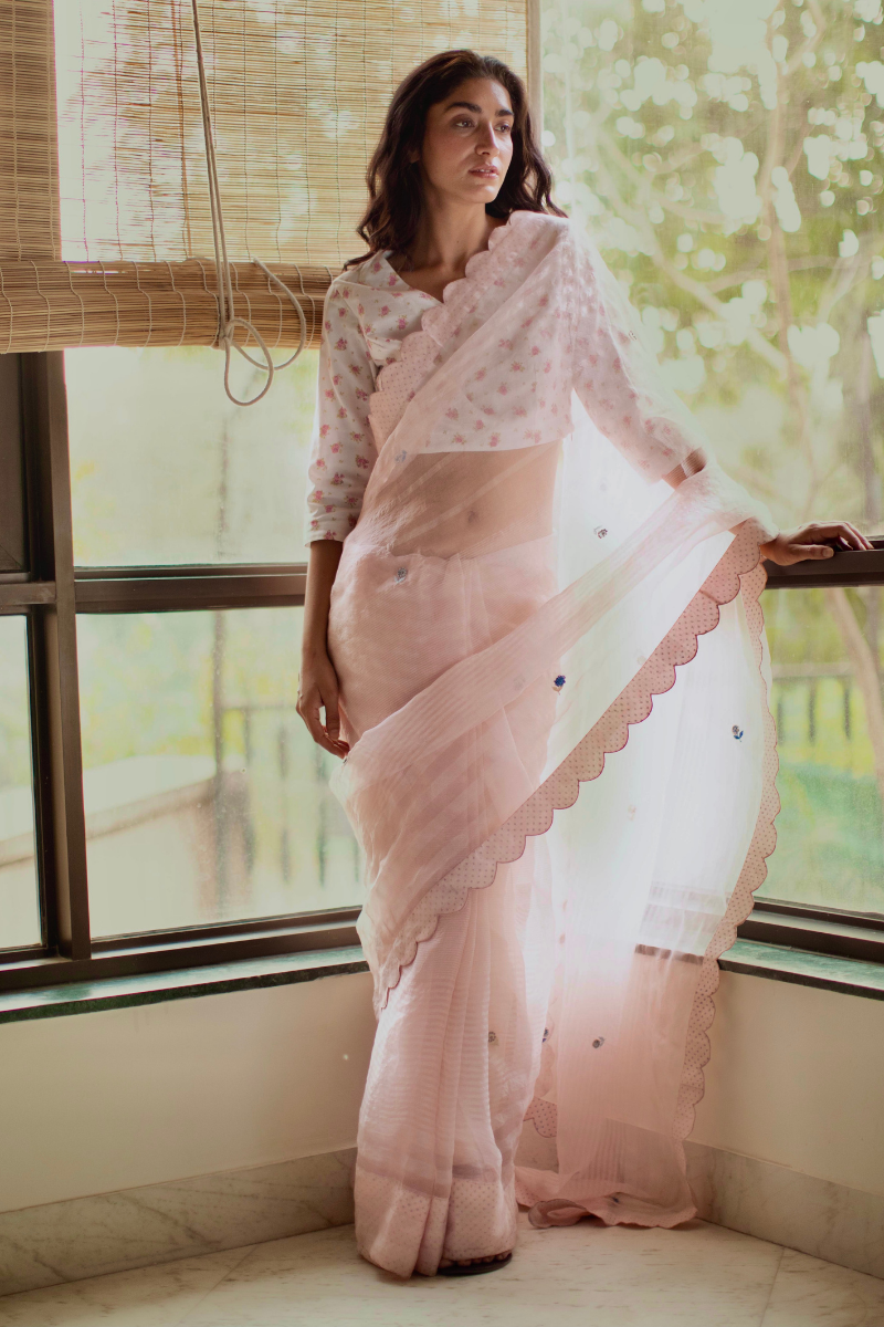 Shell pink silk organza self stripes sari with hand embroidered flowers