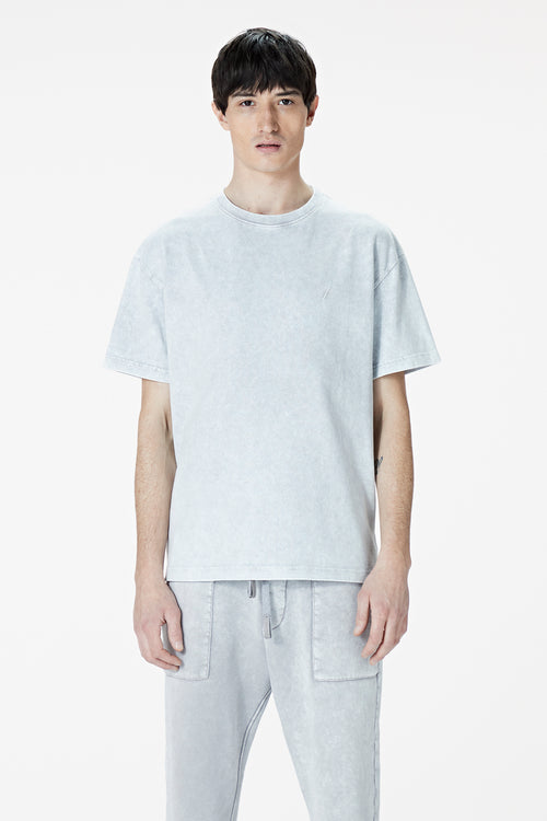 Male Model wearing the washed grey tee-shirt- BODA SKINS. Front Facing.