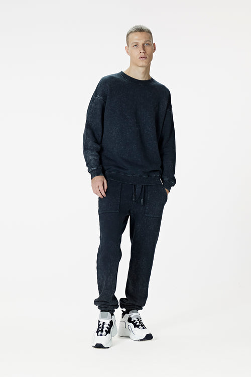 Male Model wearing black washed sweatshirt - BODA SKINS. front facing