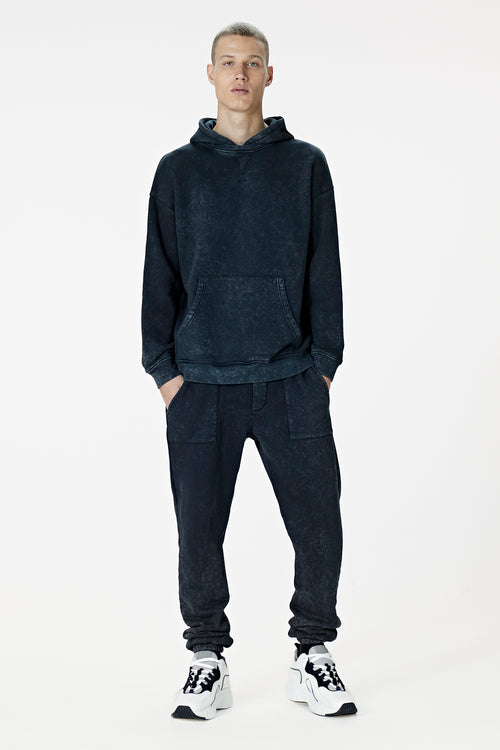 Made Model wearing washed black trackpant - BODA SKINS. Front facing.