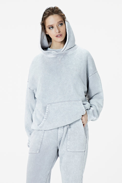 Female Model wearing washed grey hoodie - BODA SKINS. Front facing.