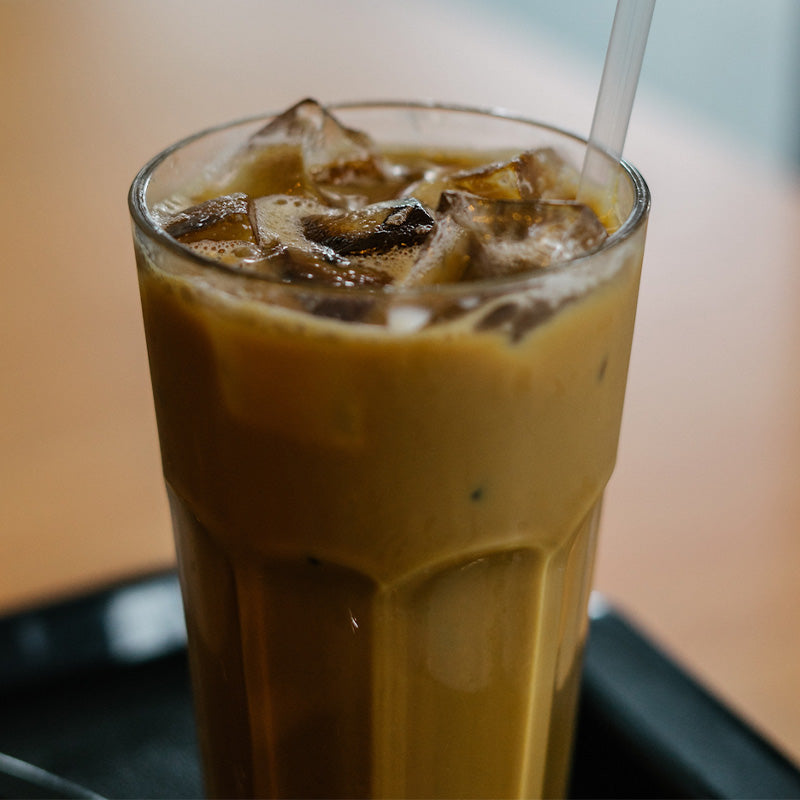 Glass of freshly brewed iced coffee.