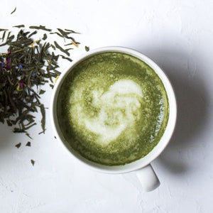 Freshly brewed matcha green tea with hot steamed milk.