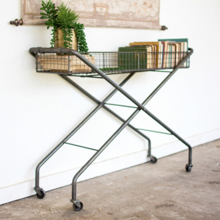 rolling metal console table with basket | modern farmhouse furniture | urban industrial furniture | shop a dash of casual furniture, home décor, kitchenware, gifts, and art online or in store | Located inside the Corner Cartel in Boerne | best boerne shops for home decor vintage items accessories and gifts