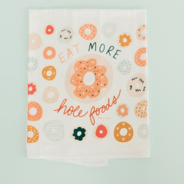 eat more hole foods flour sack tea towel | kitchen towel | kitchen linens | Shop A Dash of Casual kitchen and gift items online or in store | Located inside the Corner Cartel in Boerne | best boerne shops for home decor vintage items accessories and gifts