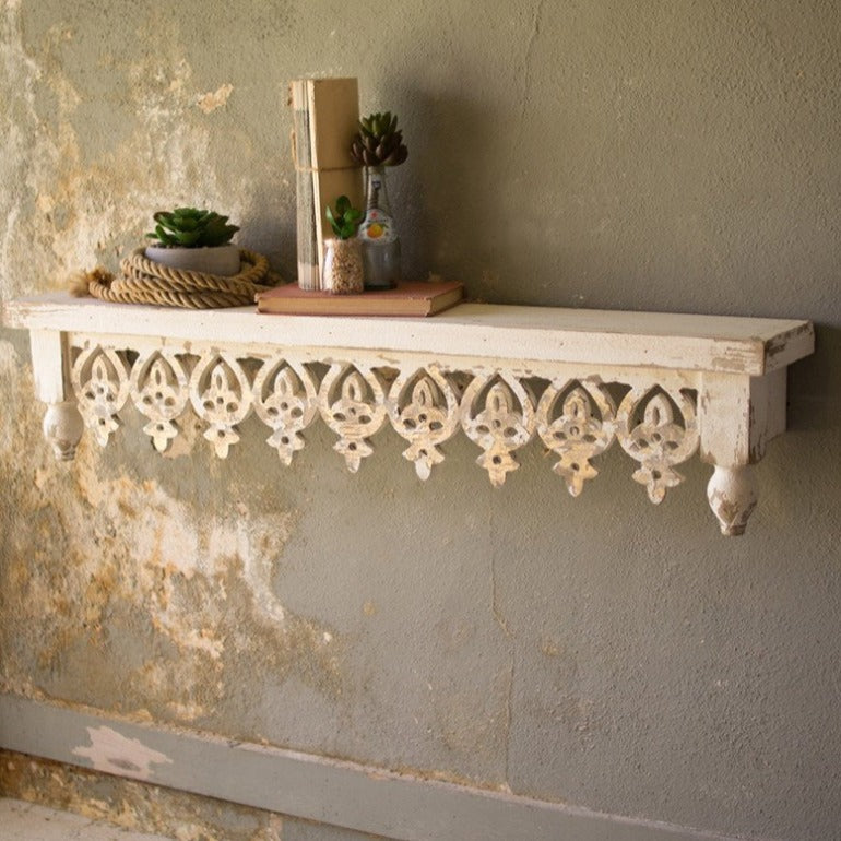 hand-carved wooden floating shelf | Moroccan detail wall shelf | furniture and home decor | shop a dash of casual home decor and art online or in store | Located inside the Corner Cartel in Boerne | best boerne shops for home decor vintage items accessories and gifts