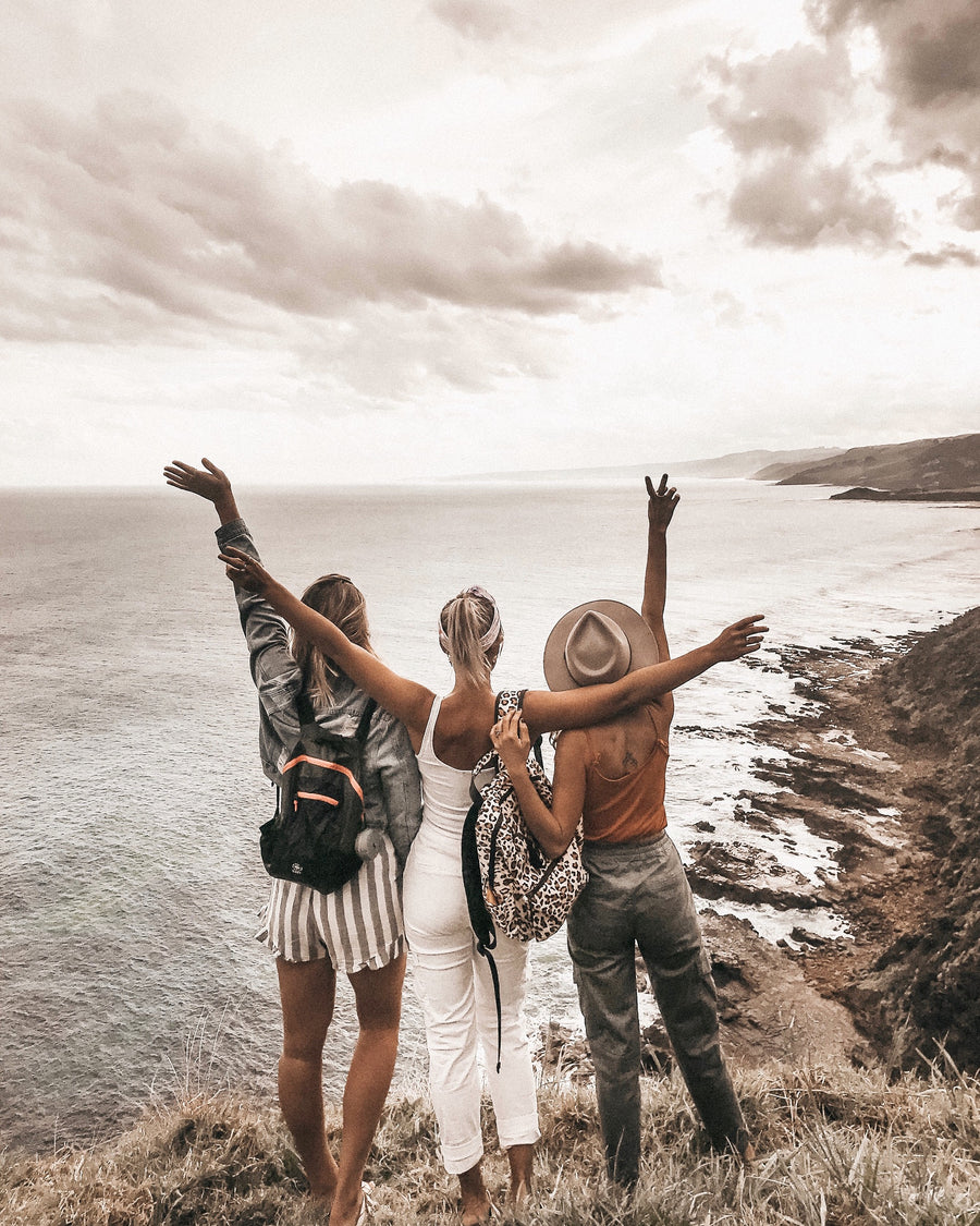 Three girls over looking the ocean on Hike & Seek 12 Apostles, Otways & Great Ocean Road day tour
