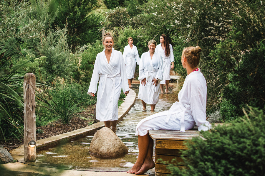 Group of friends enjoy hot springs on Hike & Seek Mornington Peninsula day tour
