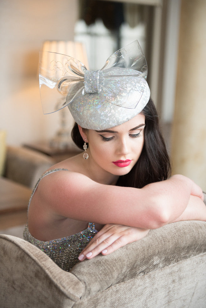 Silver beret with plastic bow