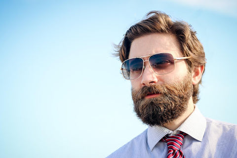 A man with a beard wearing sunglasses