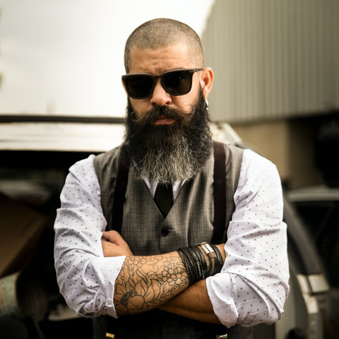 Man that has a full beard with grey tips