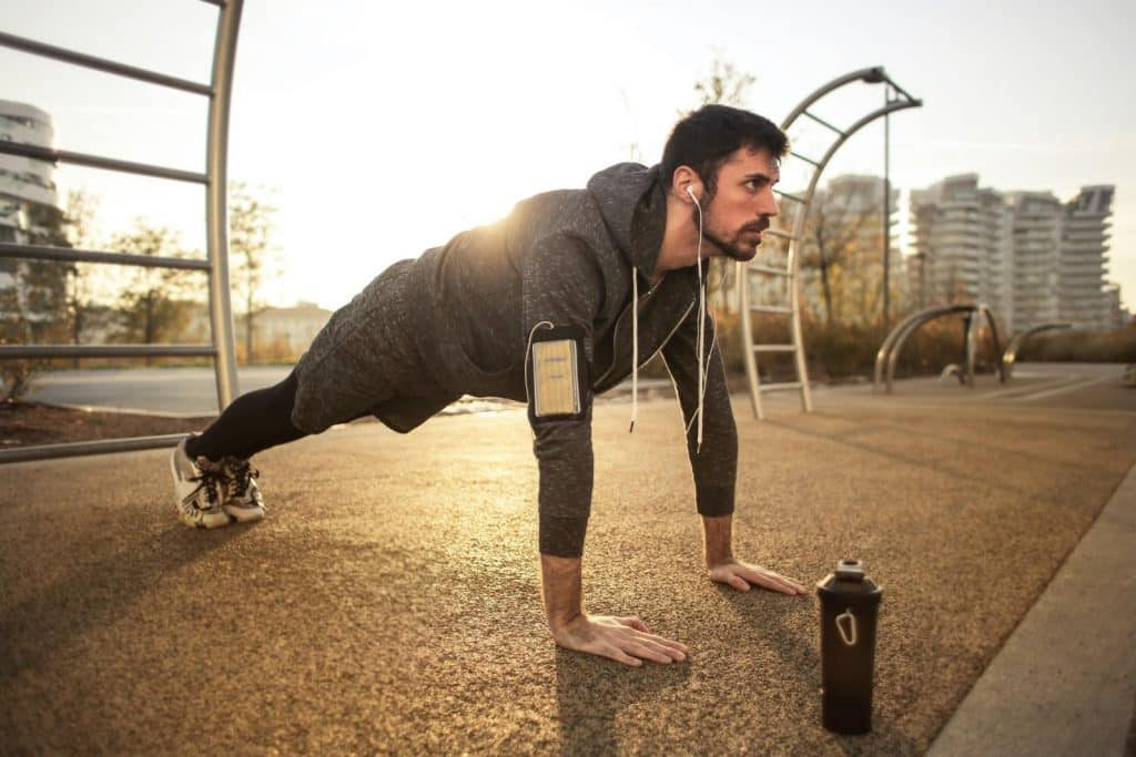 Man with beard exercising