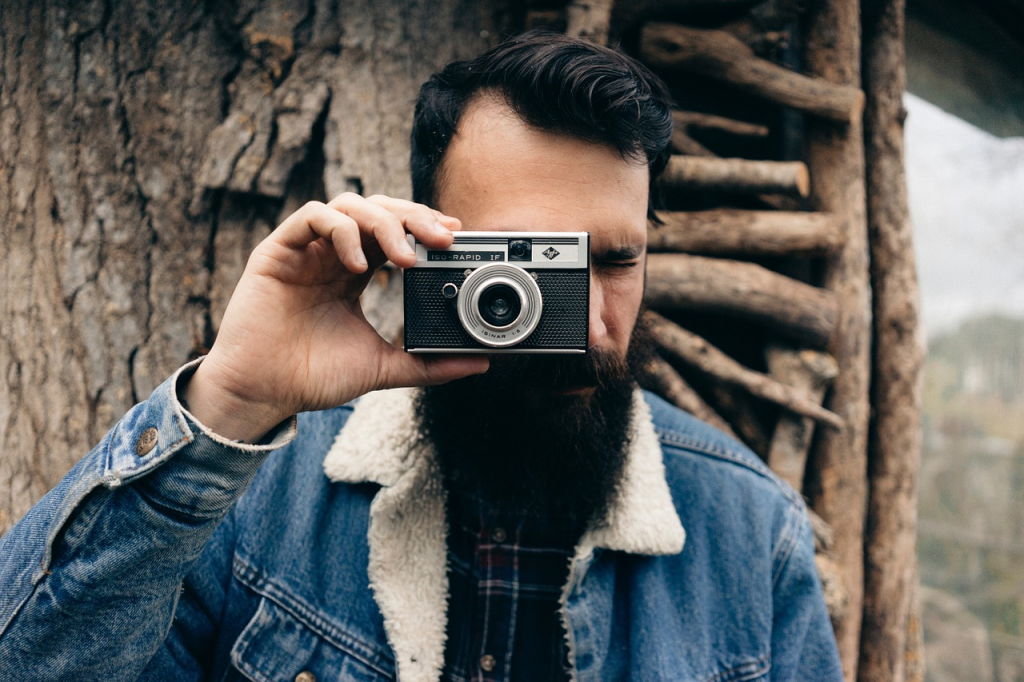 man with camera and beard