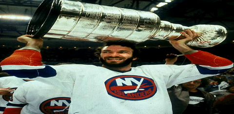 New York Islanders Ken Morrow holding the Stanley Cup