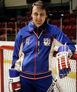 Herb Brooks smiling at the camera