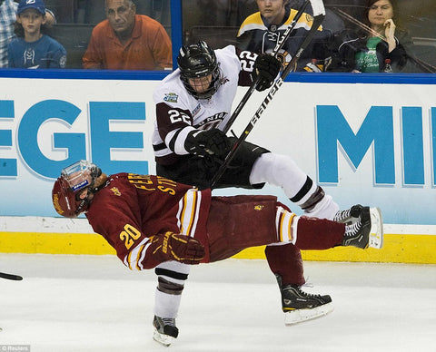 Union College Hockey Player Checks Opposing Player
