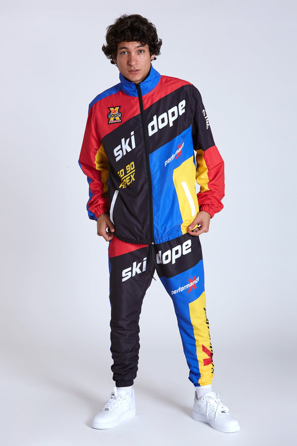 100% Polyester windbreaker with paneled construction, sublimated graphics, and rubberized chest patch applique. Self elastic wrists and waist. Polyester lining. #Red/Black #DOPE