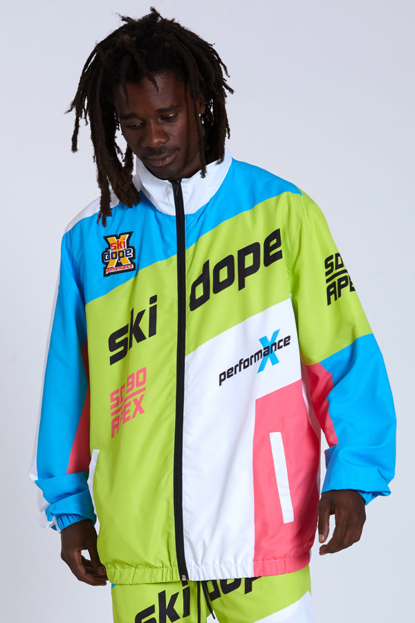 100% Polyester windbreaker with paneled construction, sublimated graphics, and rubberized chest patch applique. Self elastic wrists and waist. Polyester lining. #Blue/Green #DOPE
