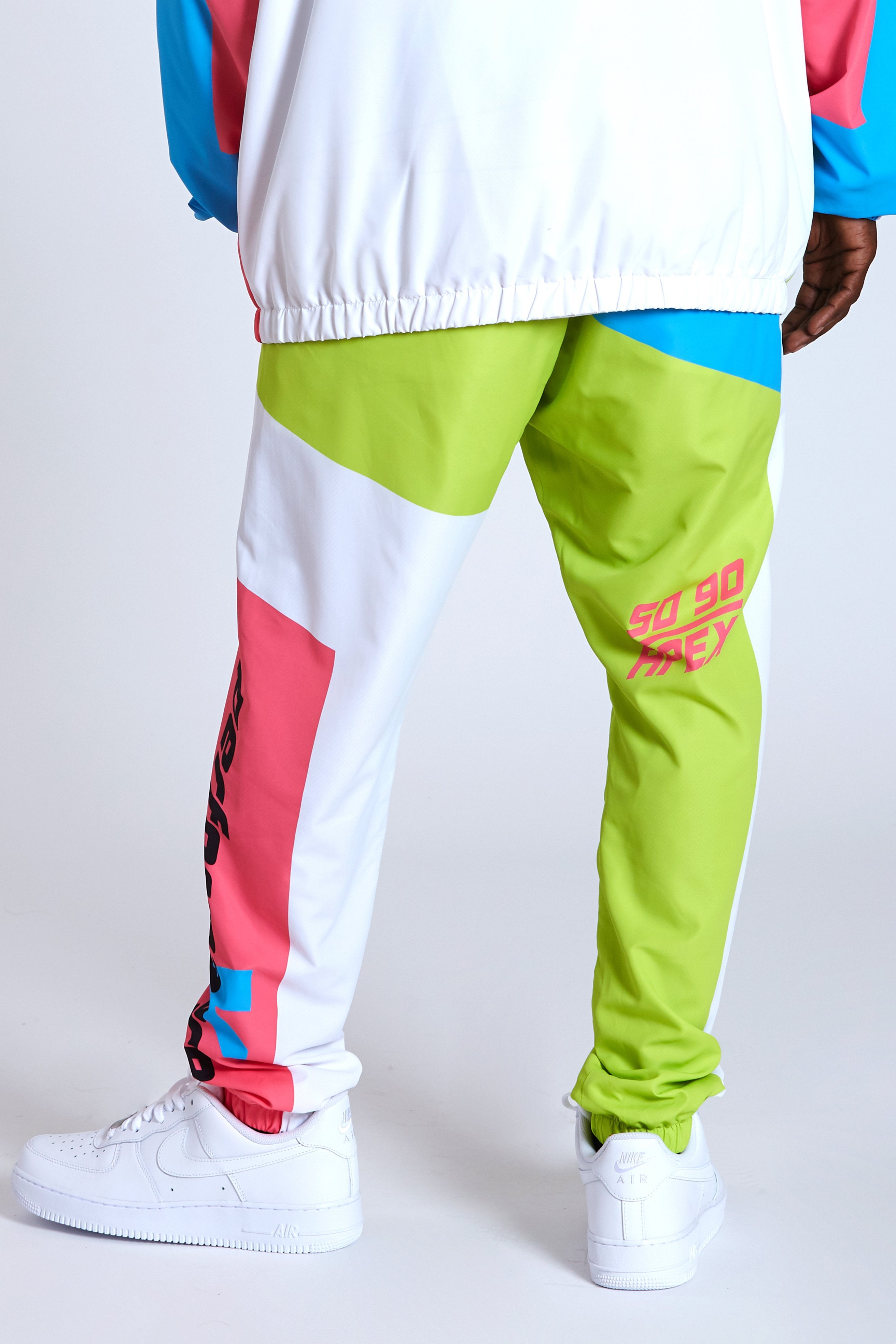 DOPE 100% Polyester windbreaker pants with elastic jogger ankle. #Blue/Green