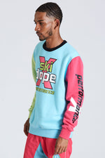 DOPE Cotton-Poly blend crewneck sweatshirt. Screen printed graphics. Contrasting sleeves and collar. #Blue/Green