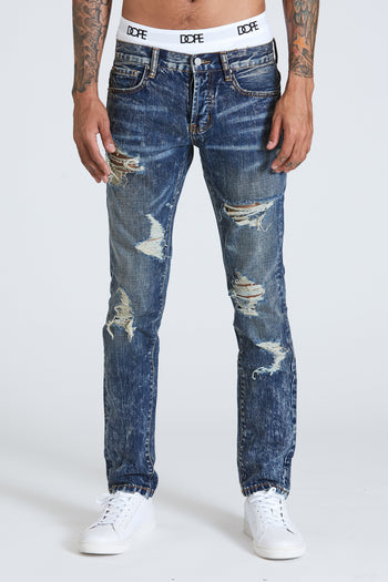 DOPE Dark Indigo Delta Denim with an acid wash and torn distressed features #Blue