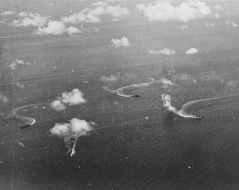 Ships of Japanese Carrier Division 3 under attack by Task Force 58 planes on 20 June 1944. Ships present include a carrier, a heavy cruiser, and a battleship. Photographed by an aircraft from USS Monterey (CVL-26).