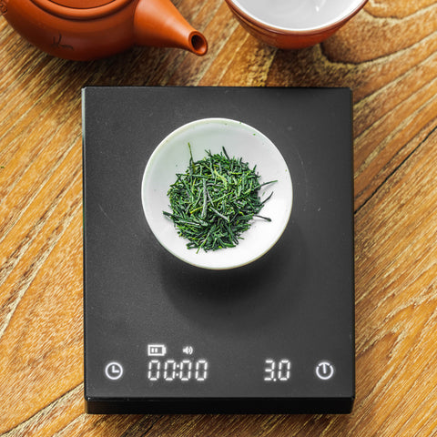 Weighing tea leaves on a scale