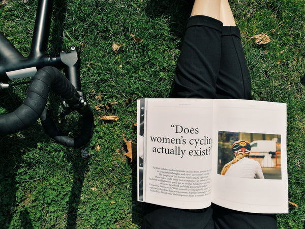 gloria ciceri women cycling reading a magazine