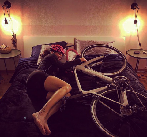 women sleeping with her bike