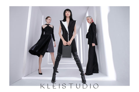 Models wearing black looks from Klei Studio's first collection for women