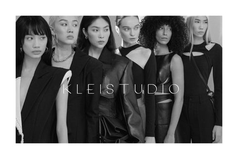 Models wearing black looks from Klei Studio's the first collection for women
