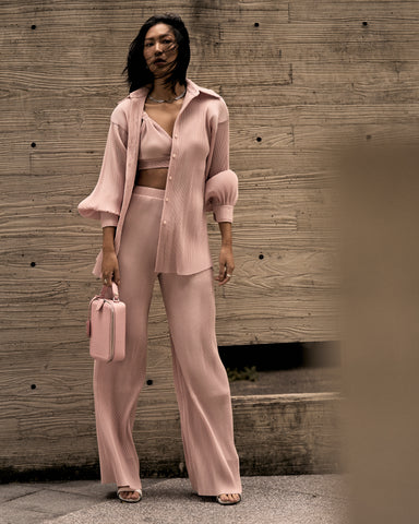Molly Chiang wears Metaphor pleated layered set from Klei Studio