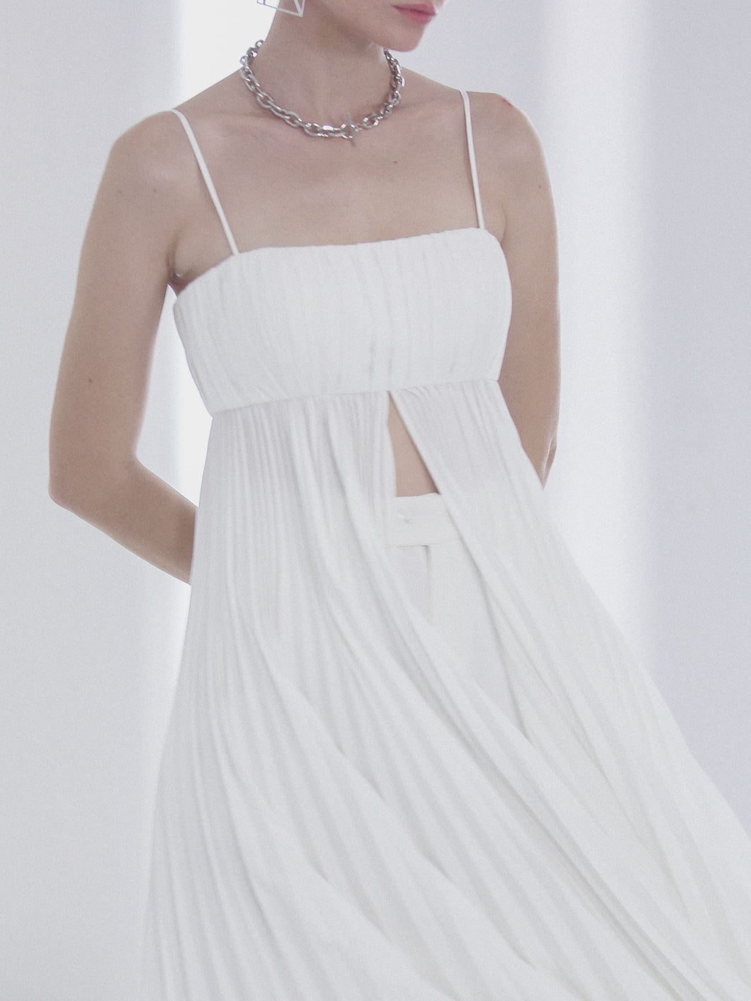 Pleated top in white for women by Klei Studio.