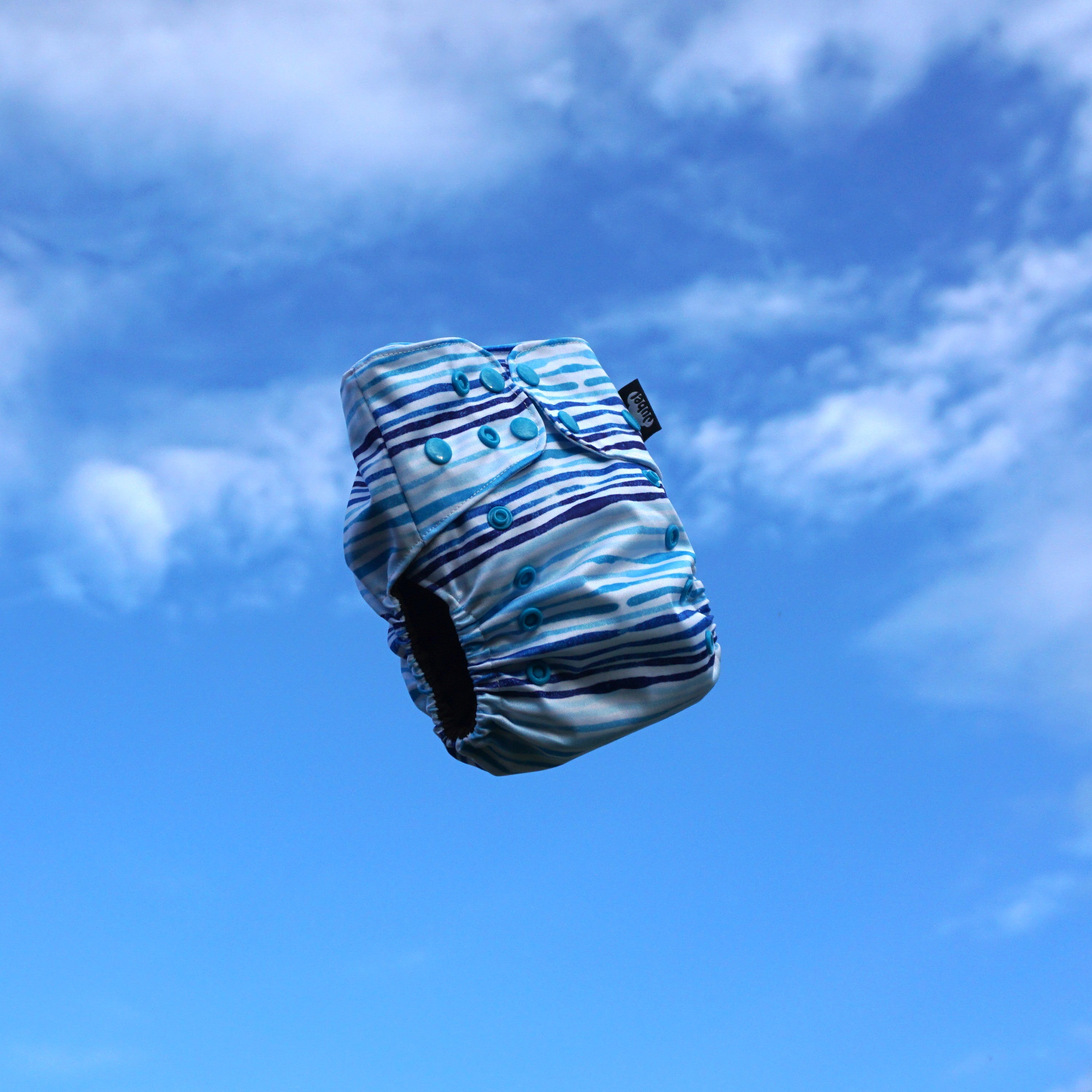 JUBEL Classic reusable nappy colour HIMMEL flying mid air