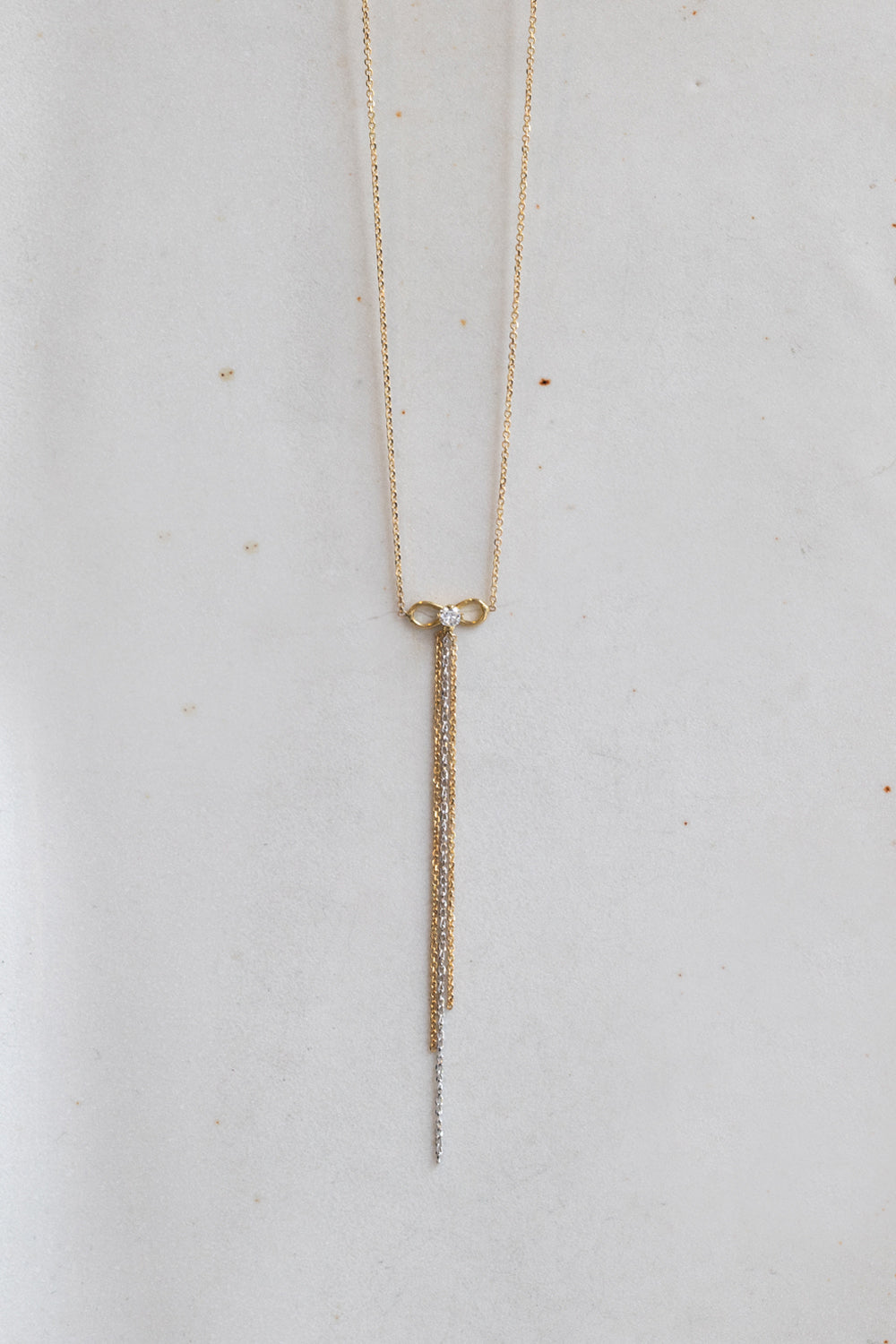 18 CT YELLOW GOLD FINE CHAIN BOW NECKLACE SET WITH WHITE BRILLIANT CUT DIAMOND