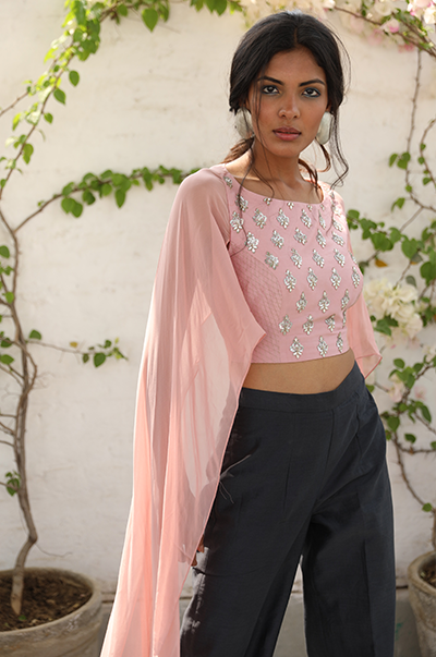 Pale pink crop top with flared sleeves and grey palazzo