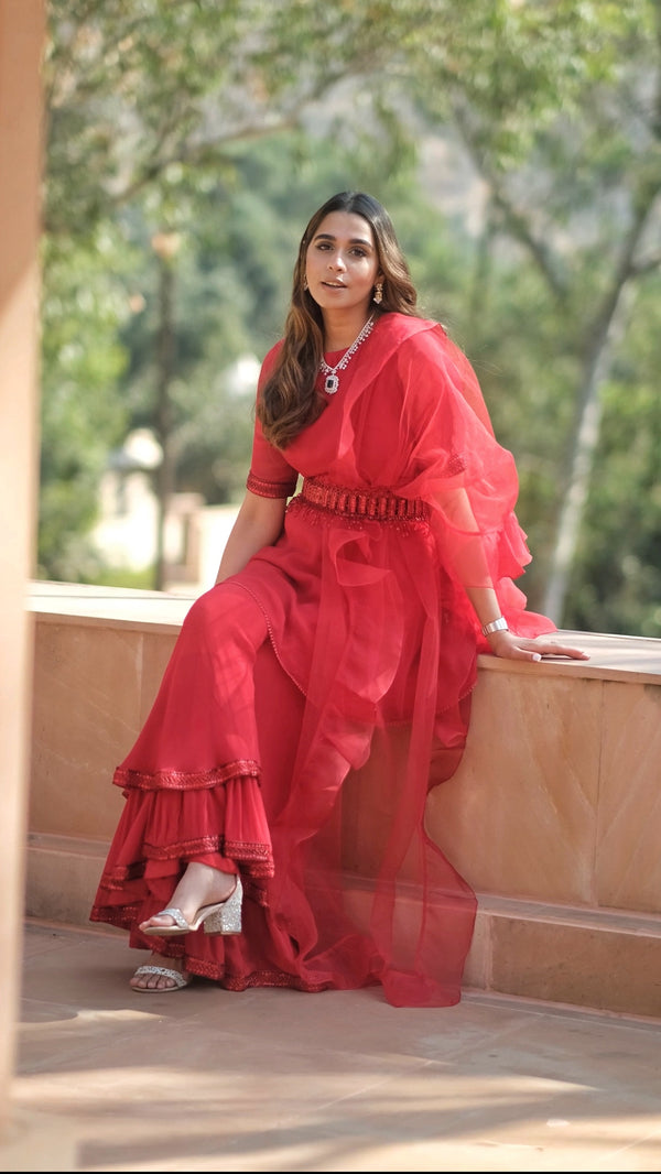 SUMMIYYA IN RED PEPLUM TOP AND DOUBLE SHARARA SET