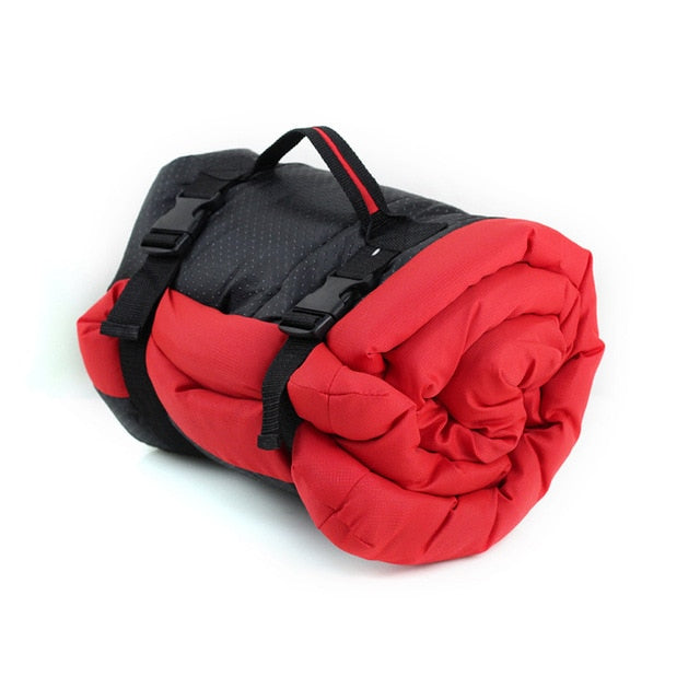 red pet cushion rolled up for easy storage and travel