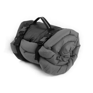 grey pet cushion rolled up for easy storage and travel