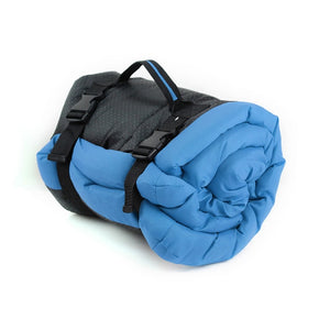 light blue pet cushion rolled up for easy storage and travel